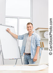 Young businessperson is writing on whiteboard. - Ready for...