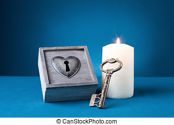 romantic still - romantic concept with a locked box, key and...