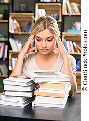 Young lady at the library looks thoroughly tired - Too much...