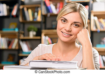 Smiling young girl in the library - Nice smile Attractive...