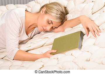 Young woman falls asleep while reading - Unintended nap...