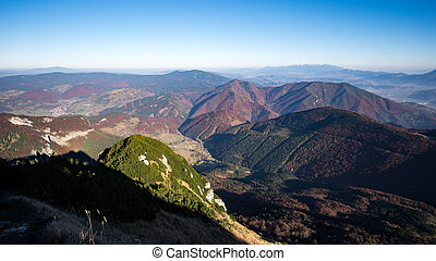 Landscape view of colorful mountain hills in fall, moody...
