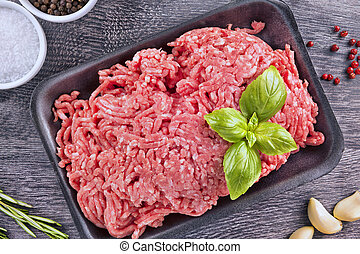 Ground beef - Lean ground beef in black styrofoam meal box,...