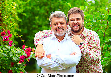 portrait of happy father and son, which are similar in...