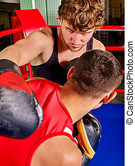 Two men boxer wearing helmet boxing - Two aggresive men...