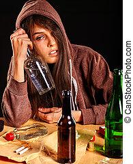 Drunk girl holding bottle of vodka. - Drunk girl hugging a...