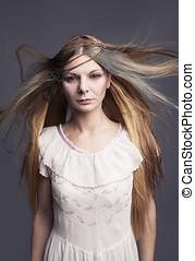 curiosity - innocent hippie like lady with flying hair...
