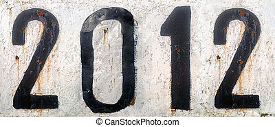 Rusty metal plate with numbers