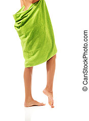 Well groomed female legs wrapped in towel.