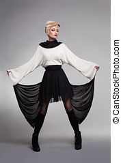 tulle skirt - fashion model wearing a black and white dress...