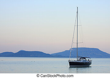 Sill-life - A sailboat is waiting in evening stillness