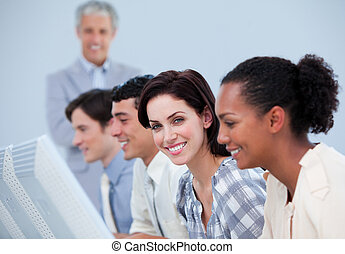 Positive business team at work with their manager in the...
