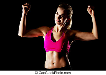 Woman shows her muscles - Yong woman shows her muscles