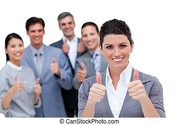 A diverse business team with thumbs up