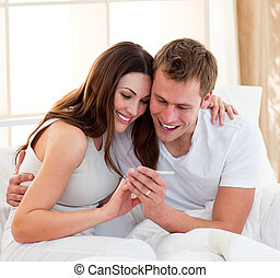Joyful couple finding out results of a pregnancy test...