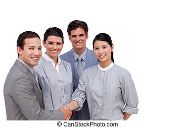 Confident business partners shaking hands against a white...