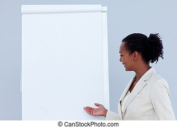Afro-american businesswoman giving a presentation in a...