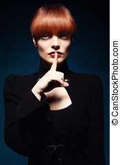 shh finger - beautiful woman with straight red hair doing...