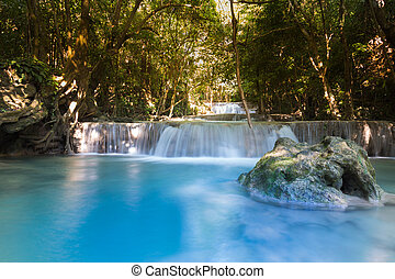 Blue stream water falls in deep forest national park of...
