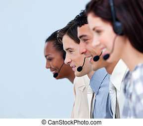 Cheerful customer service representatives in a call center