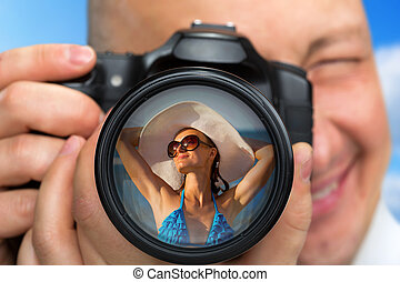 Photographer capturing portrait of bikini girl