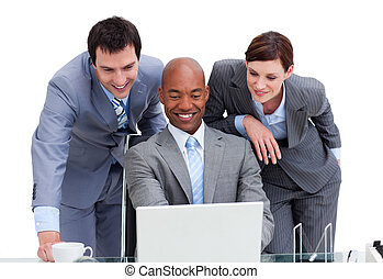 United colleagues looking at a laptop