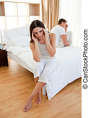 Afflicted couple after having an argument in the bedroom