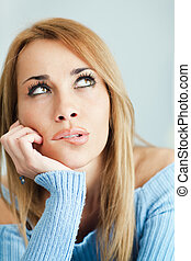 pensive woman biting lips - portrait of woman thinking and...