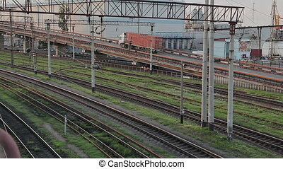 Railway Tracks And Road With Trucks