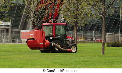 Tractor Leaf Blower - Tractor leaf blower at lawn of public...