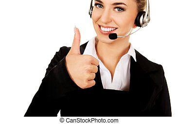 Call center woman with headset gesturing OK