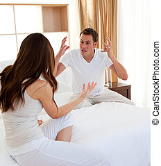 Afflicted couple having an argument  in the bedroom