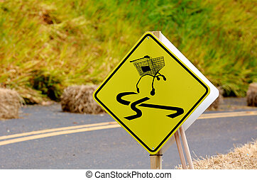 Dangerous slippery road sign of shopping trolley on the...