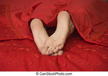 Woman's legs in bed