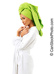 Woman in bathrobe and towel on head