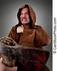 Furious medieval executioner with big bloody axe