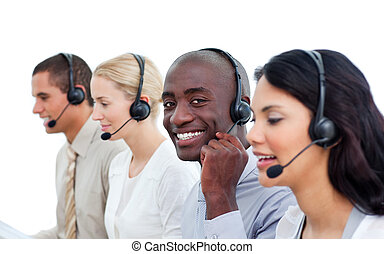 Attractive man and his team working in a call center against...