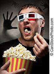 Scared man watching 3D movie - Portrait of scared man...