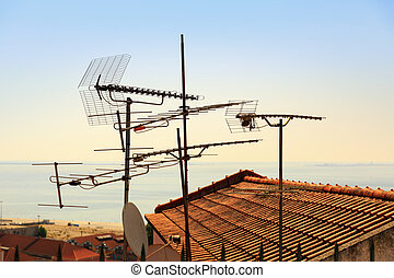 Antennas on the roof - Many antennas and satelites on the...