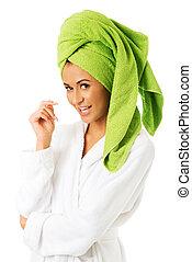 Woman in bathrobe looking at camera