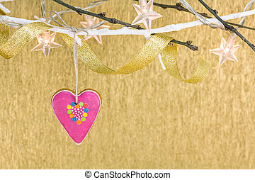 christmas holiday lights with gingerbread heart and ribbon