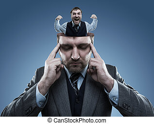Crazy man in the head of young businessman on blue