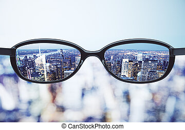 Clear vision concept with eyeglasses and night megapolis...
