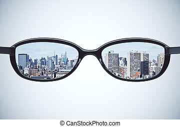 Clear vision concept with eyeglasses with megapolis city at...