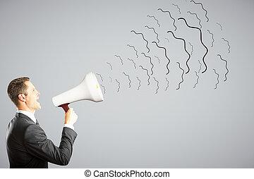 Businessman shouts through megaphone