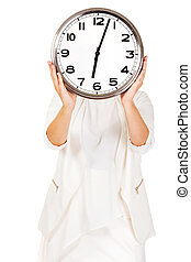 Businesswoman covering face with clock.