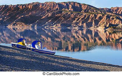 Lake - Idyllic restful lake Scene showing two peddle boat at...