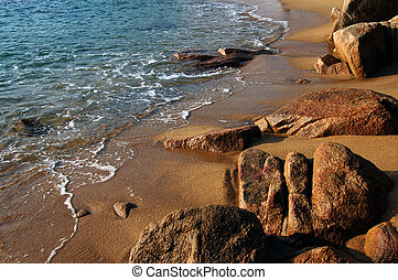 rocky shore - Golden sand and rocky shore