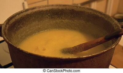 Boiling Polenta in Cauldron - Mixing and boiling a...