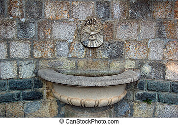 fountain with high relief - old abandoned dry fountain with...